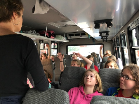 Susan leading a devotion time on the bus with the middle school girls.